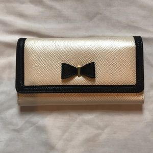 Black and cream colored wallet